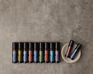 doTERRA Touch Enrolment Kit on a gray stone background with copyspace to add your message.