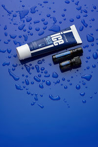 doTERRA Ice Blue Athletic Cream, Athletic Blend Roll On and Athletic Blend 5ml on blue perspex with water drops.