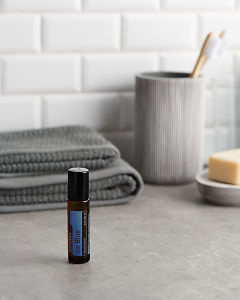 doTERRA Ice Blue Touch with bathroom acessories on a bathroom bench top.