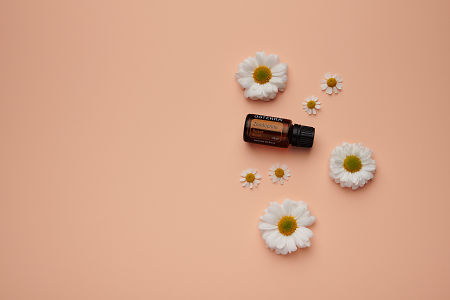 doTERRA Zendocrine with white flowers on a pale coral orange card stock background.