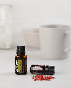 doTERRA Marjorman 15ml and doTERRA Pink Pepper 5ml with pink peppercorns on a white background.