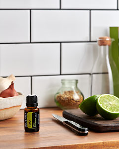 doTERRA Lime on a kitchen bench with freshly cut lime.