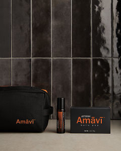 doTERRA Amavi Touch, Amavi Bath Bar and Amavi bag on a gray stone bathroom bench.