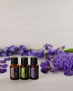 doTERRA Geranium, Lime and Lavender with scattered purple flowers on white.
