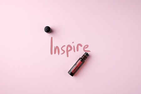 doTERRA Passion Touch on a light pink colored background.