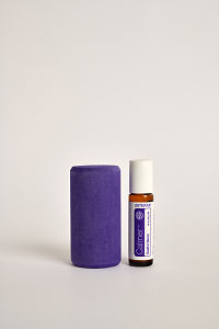doTERRA Kids Oil Collection roll-on bottle Calmer next to a purple wooden block.