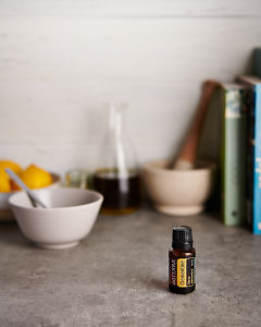 doTERRA Clementine with kitchen equipment on a gray stone kitchen bench.