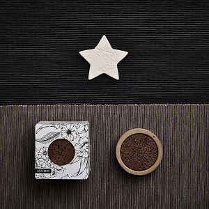 doTERRA Concrete Lava Rock Diffusers with a star on a dark and medium gray textured background.