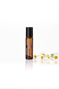 doTERRA Neroli Touch with flowers on a white background with reflection.