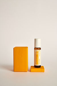 doTERRA Kids Oil Collection roll-on bottle Thinker on an yellow wooden block.