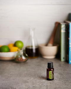 doTERRA Lemongrass with kitchen equipment on a gray stone kitchen bench.