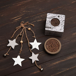 doTERRA Concrete Lava Rock Diffusers and holiday decorations on a brown wooden background.