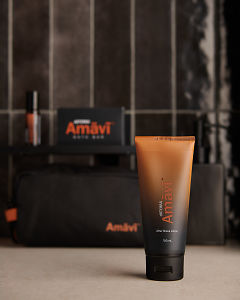 doTERRA Amavi After Shave Lotion on a gray stone bathroom bench.