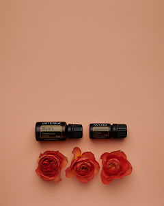 doTERRA Myrrh and Sandalwood with orange roses on a pale orange card background.
