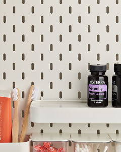 doTERRA Serenity Softgels on a bathroom shelf with additional doTERRA products and bathroom accessories.