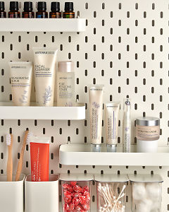 doTERRA Essential Skin Care products on a bathroom shelf with bathroom accessories and additional doTERRA products.