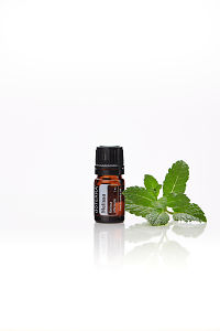 doTERRA Melissa with melissa leaves on a white background with reflection.
