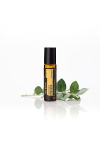 doTERRA Manuka Touch with leaves on a white background with reflection.