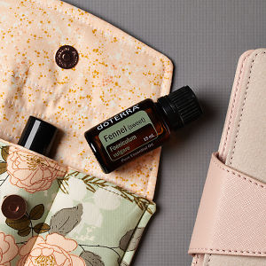 doTERRA Fennel on an essential oil bag with a diary on a gray textured background.