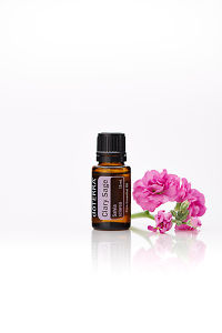 doTERRA Clary Sage with flowers on a white background with reflection.