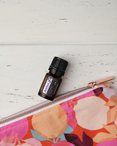 doTERRA Anchor and an essential oil bag in close up on a white wooden background.