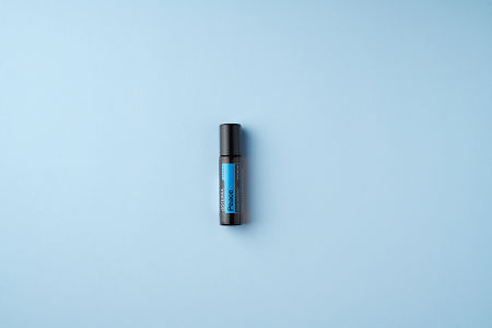 doTERRA Peace Touch on a light blue colored background.