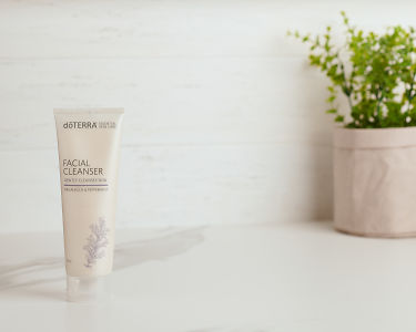 doTERRA Essential Skin Care Facial Cleanser on a white marble bench.