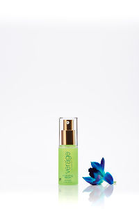 doTERRA Verage Immortelle Hydrating Serum with a blue orchid on a white background with reflection.