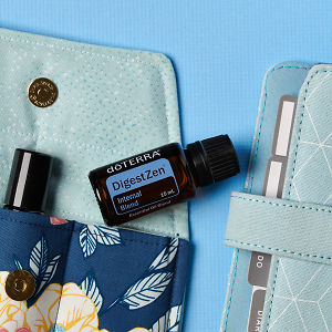 doTERRA DigestZen on an essential oil bag with a diary on a blue textured background.