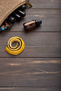 doTERRA Smart and Sassy, lemon peel and clutch with oils on brown wooden background.