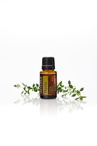 doTERRA Thyme with thyme leaves on a white background with reflection.