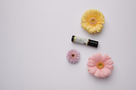 doTERRA Salubelle with flowers on a white background.