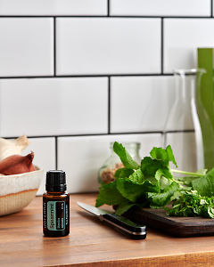doTERRA Spearmint on a kitchen bench with fresh spearmint.