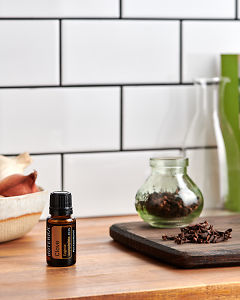 doTERRA Clove on a kitchen bench with clove buds.