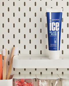 doTERRA Ice Blue Rub on a bathroom shelf with additional doTERRA products and bathroom accessories.
