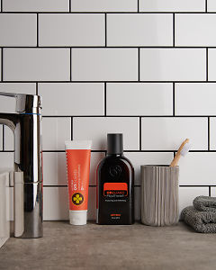 doTERRA On Guard Natural Cleansing Toothpaste and On Guard Mouthwash in a bathroom setting.