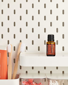 doTERRA On Guard Protective Blend on a bathroom shelf with additional doTERRA products and bathroom accessories.