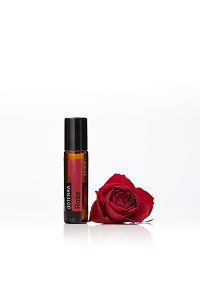 doTERRA Rose Touch with a red rose on a white background with reflection.