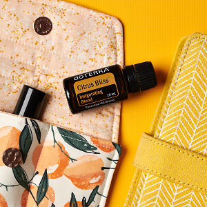 doTERRA Citrus Bliss on an essential oil bag with a yellow diary on a yellow textured background.
