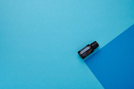 doTERRA DigestZen on a dark blue and light blue geometric background.