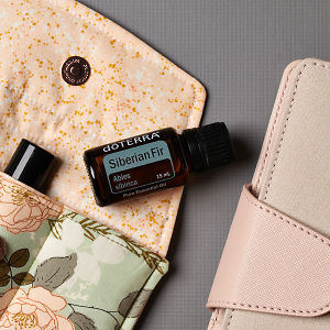 doTERRA Siberian Fir on an essential oil bag with a diary on a gray textured background.