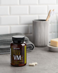 doTERRA AMicroplex VMz with bathroom acessories on a bathroom bench top.