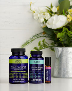 doTERRA Bone Nutrient Essential Complex, Phytoestrogen Essential Complex and Clary Calm with flowers on a white benchtop.