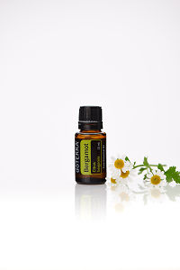 doTERRA Bergamot with flowers on a white background with reflection.