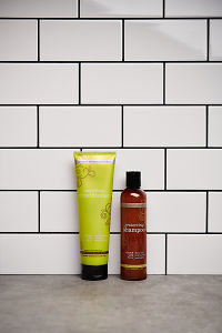 doTERRA Salon Essentials Protecting Shampoo and Smoothing Conditioner on a stone bathroom benchtop.