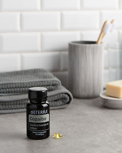 doTERRA Copaiba Softgels with bathroom acessories on a bathroom bench top.
