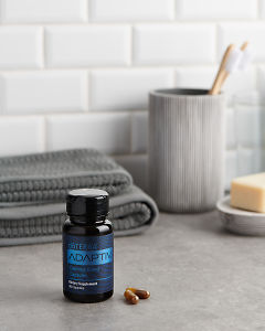 doTERRA Adaptiv Calming Blend Capsules with bathroom acessories on a bathroom bench top.