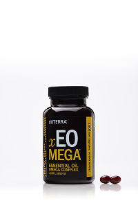 doTERRA xEO Mega with two capsules on a white background with reflection.
