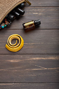 doTERRA Lemon, lemon peel and clutch with oils on brown wooden background.