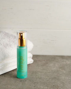doTERRA Verage Moisturizer with a white towel on a stone bathroom bench top.